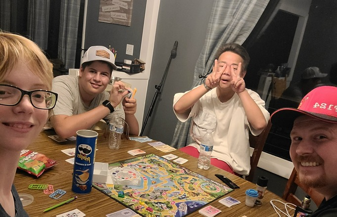 Family game night with around the table