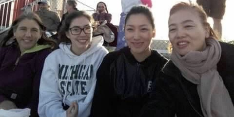 American mother and daughter with Korean mother and daughter