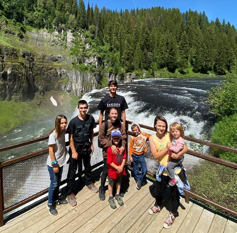 family in front of waterfall