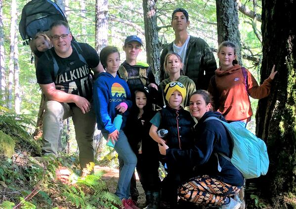 large family hiking in forest