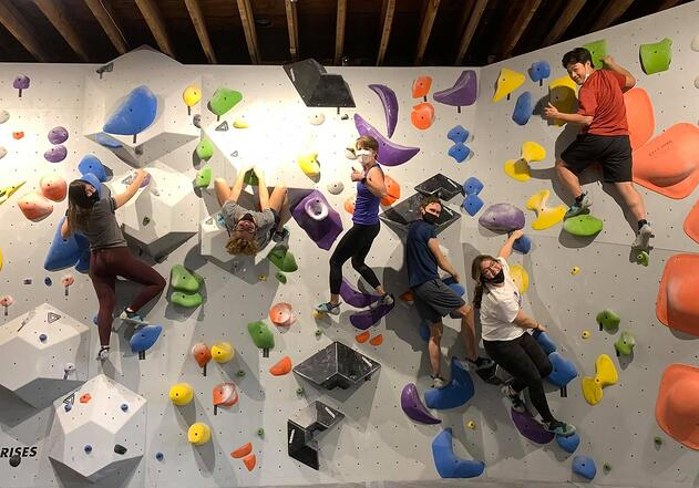 Chihok and 3 other teens on a colorful climbing wall