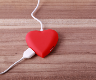 red heart with two cords plugged in