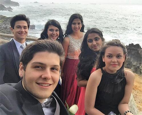 Dan with group of teens dressed up for prom