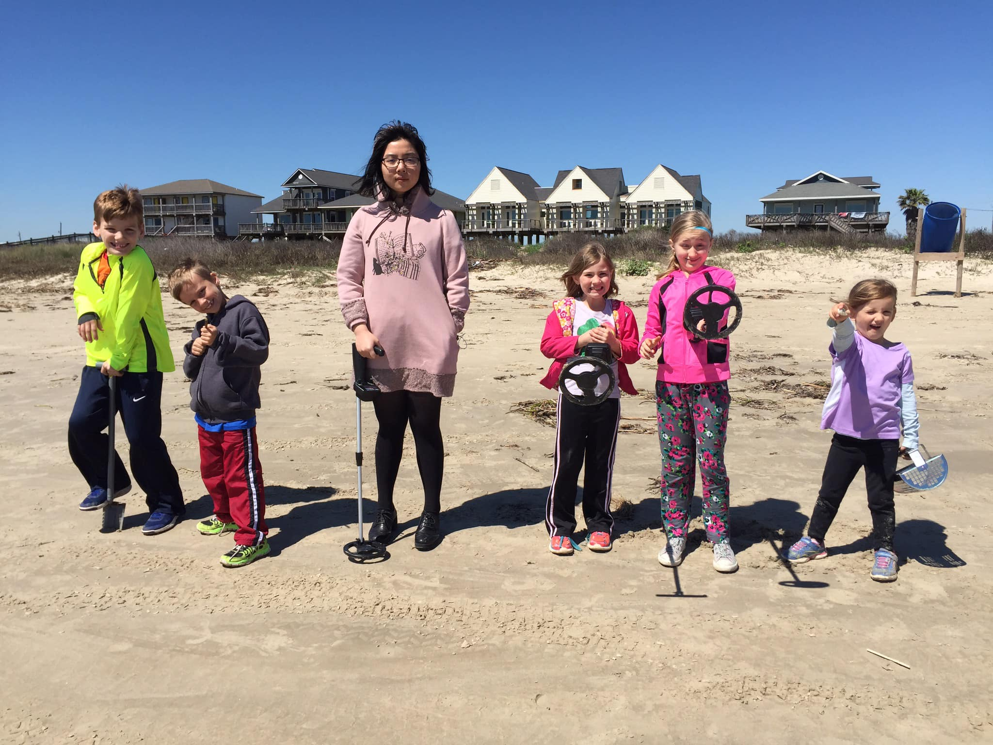 5 kids and Chinese girl at beach