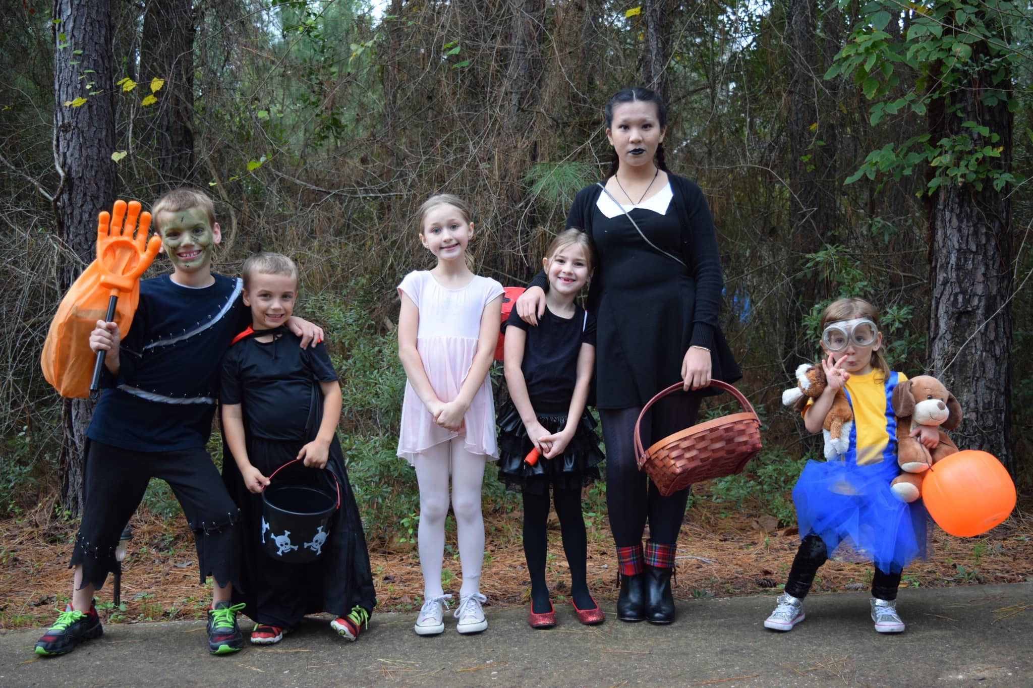 young kids and exchange student in Halloween costumes