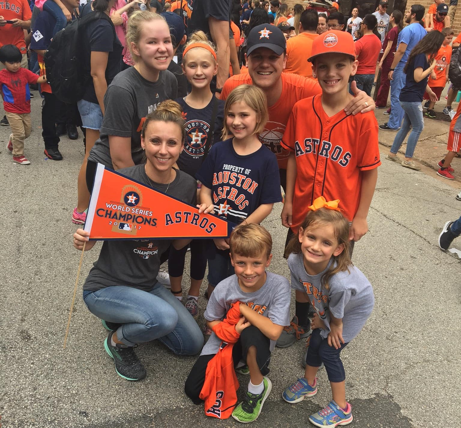 family huddled in Astros gear and pendant