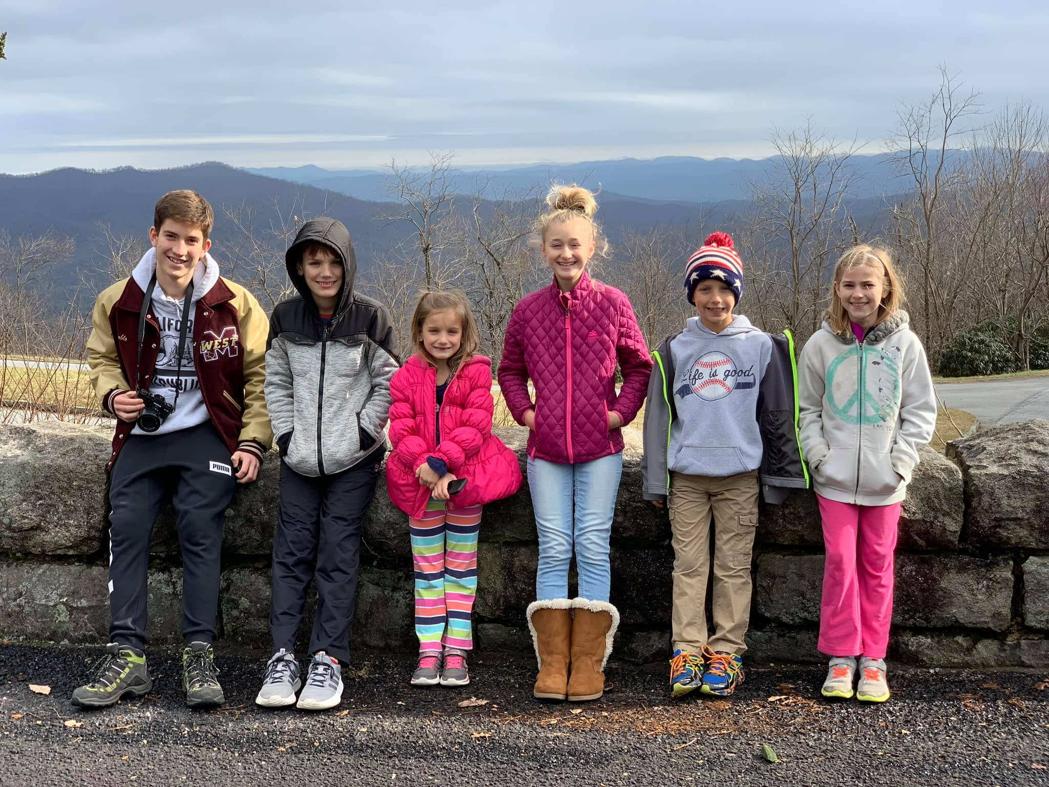 exchange student and five kids with mountain background