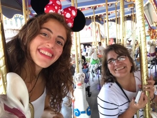 teen girl and host mother on carousel