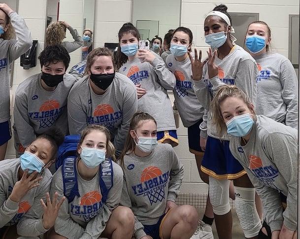 Girls basketball team in locker room