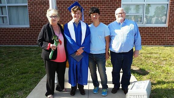 older couple and exchange students at graduation