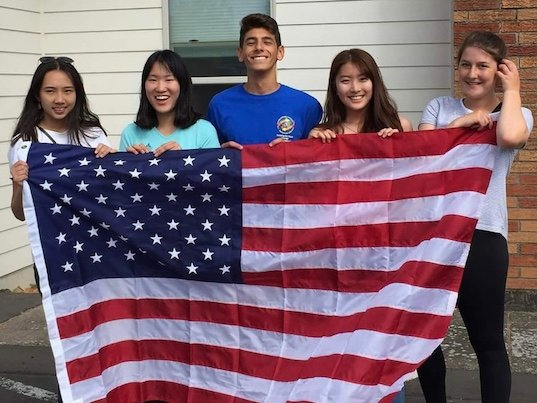 international exchange students with American flag