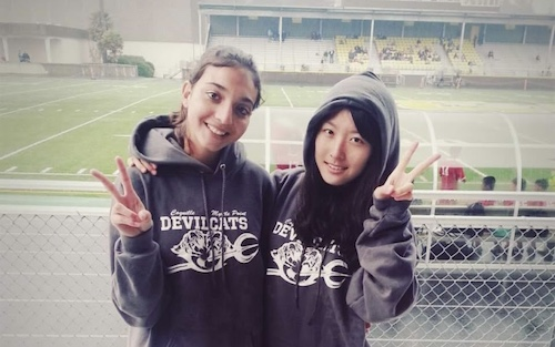 Korean exchange student and friend at football field