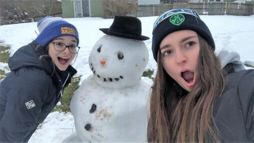 Ivona and host sister posing with a snowman