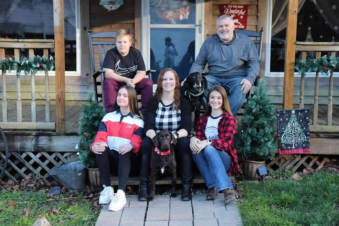 Ivona and host family sitting on the front porch