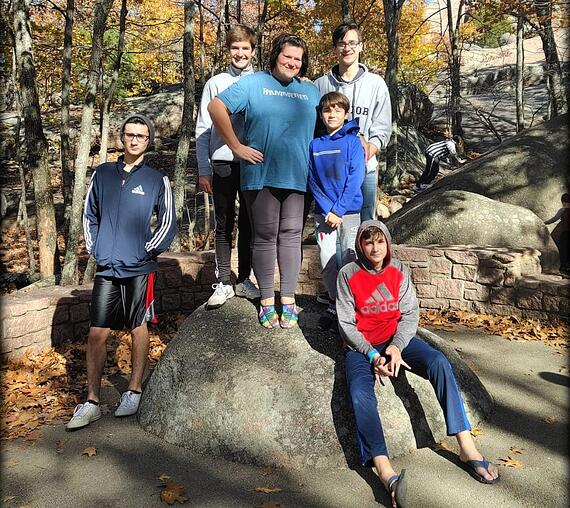 host mom and five boys in a park in the fall