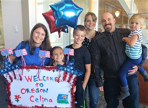 Family with young kids greeting exchange student
