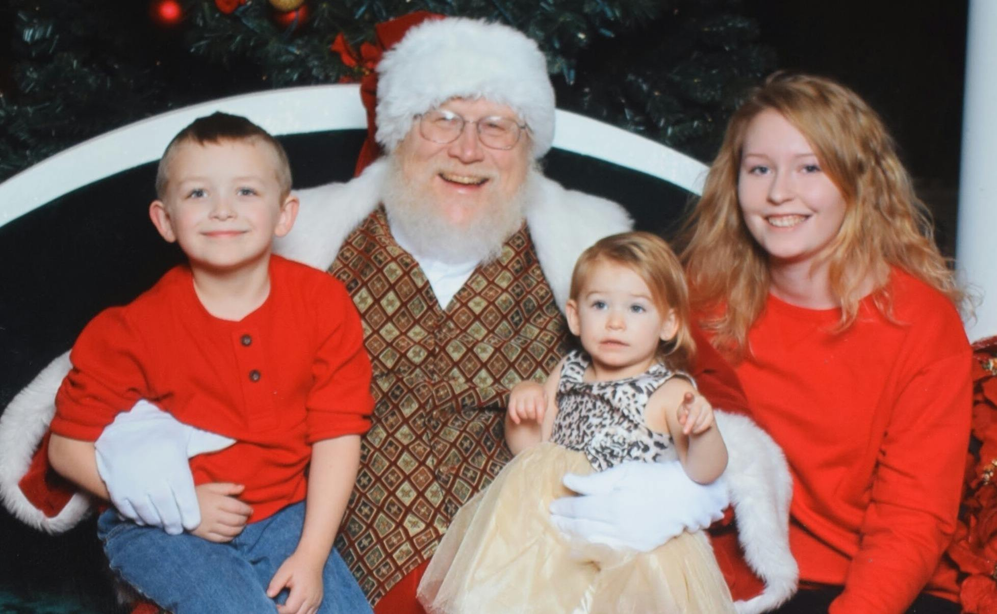 German exchange student and young host siblings with Santa Claus