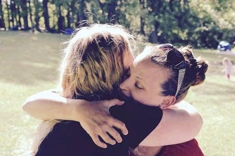 German student giving host mom a big hug