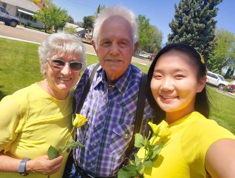 Asian girl taking selfie with senior couple