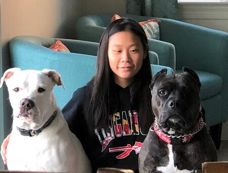teen girl with two dogs