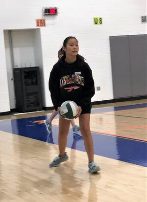 girl preparing to serve volleyball