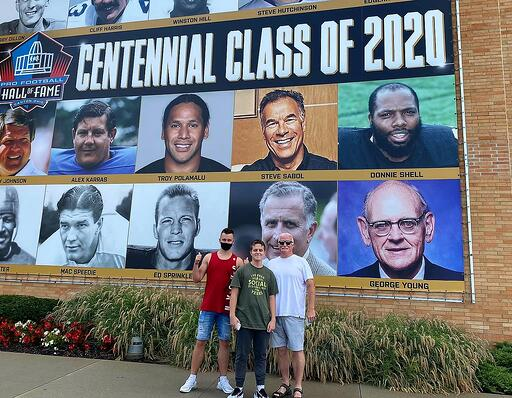 boys and host dad in front of Centenial Class of 2020 at NFL Hall of Fame