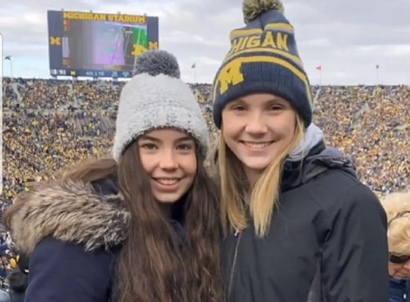 two teenage girls at University of Michigan football game