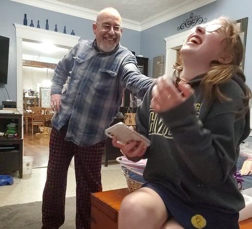 teen girl lauging hard at dad
