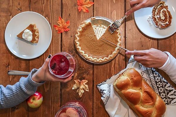 Pumpkin pie with sweet bread and cranberry juice for Thanksgiving to teach gratitude and share US culture and customs