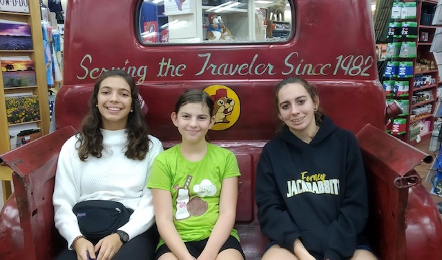 Spanish teenage girl with two american host sisters in the back of an antique truck