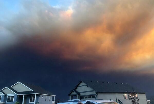 ominous black smoke approaching homes
