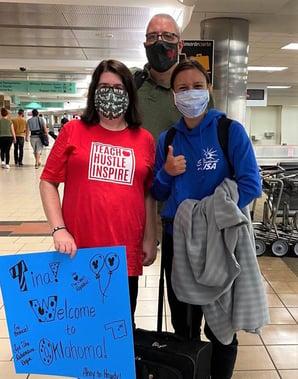 Host parents and Tina at airport