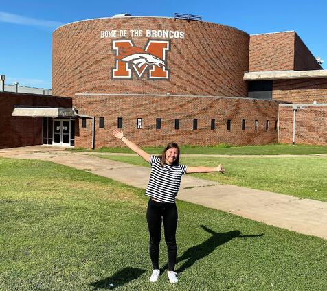 Tina in front of American school