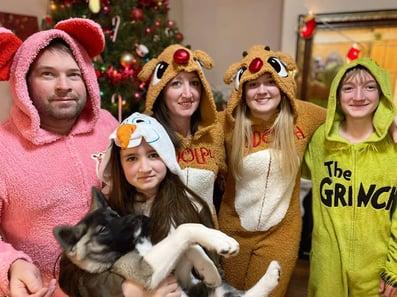 family in funny Christmas pajamas