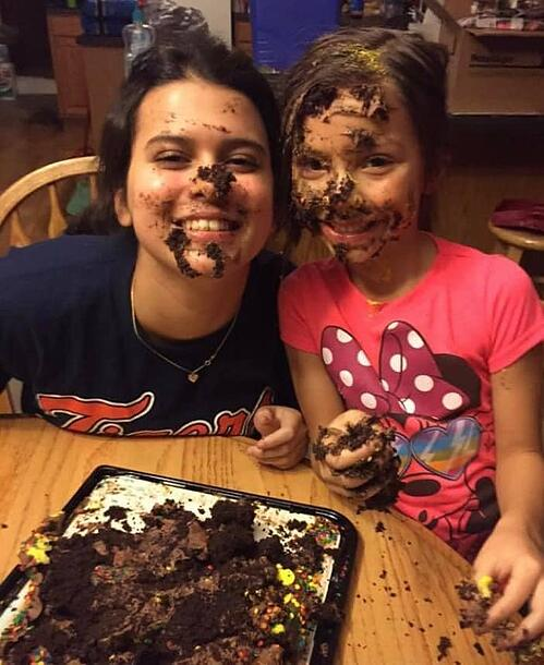 teen and young girl with dough on faces