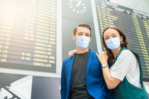 masked teens at airport