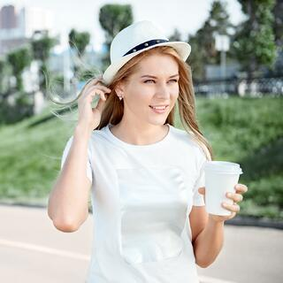 woman walking and holding coffee