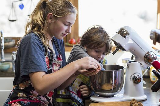 girl making cookies with child