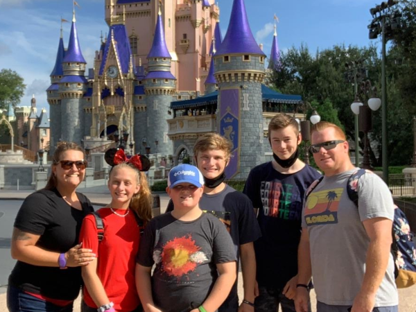 German exchange student with his host family at Disney's Magic Kingdom