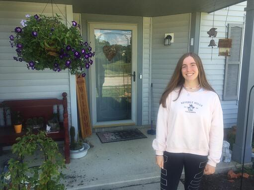Exchange student from Spain standing in front of US host family home in Indianapolis