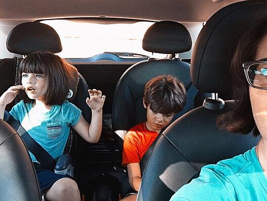 kids in the back seat of the car