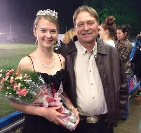 host father with exchange student crowned homecoming queen