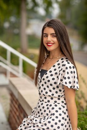beautiful Spanish exchange student posing in a black and white polka dot dress