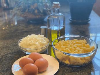 whole eggs, chopped onions, potatoes