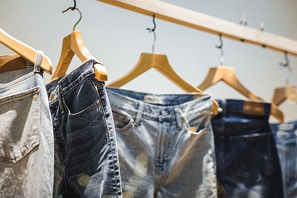 jeans hanging on a hanger