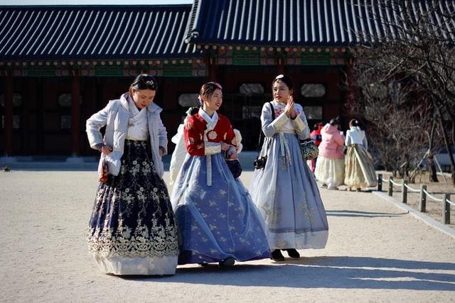 three korean teenage girls in traditional dress