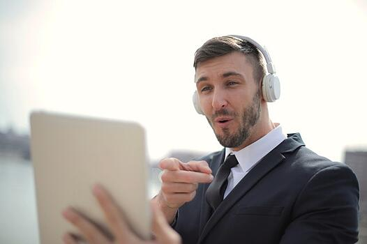 man having a conversation via tablet