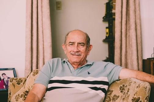 older man sitting in living room
