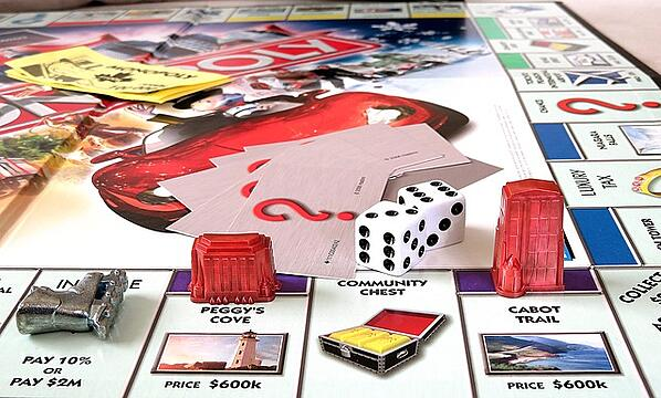 playing tokens on a Monopoly board