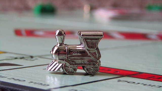 Monopoly train token on a space of the game board